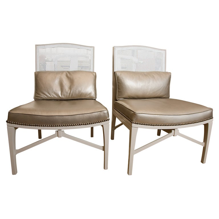 Pair Moderne glam chairs in leather and cane at 1stdibs