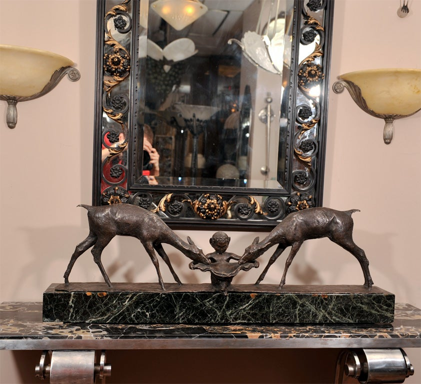 "A black patinated bronze group ""Two Deer and Faun"" by Ary Bitter (French, 1883-1973), from circa 1925. Signed and with foundry mark, ""Susse Frères"" on the bronze plinth. Mounted on a green marble base."