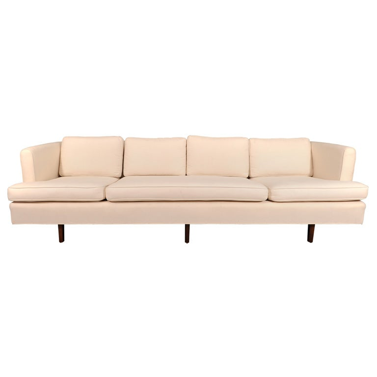 Tailored Sofa Upholstered In White Canvas Upholstery At