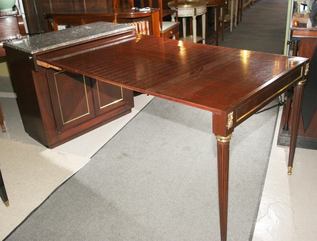 jansen cabinet converts to dining table at 1stdibs