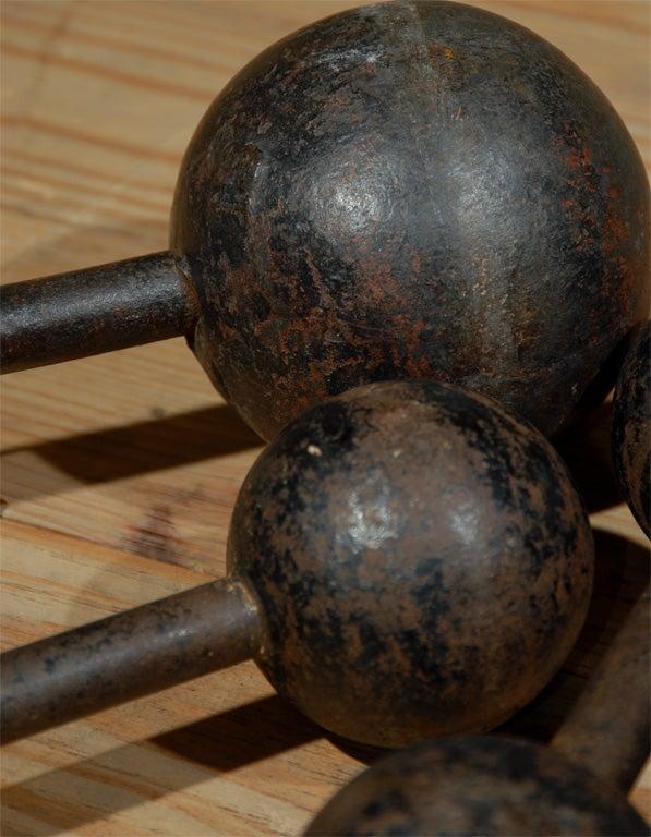 Iron set of six vintage cast iron bar bells For Sale