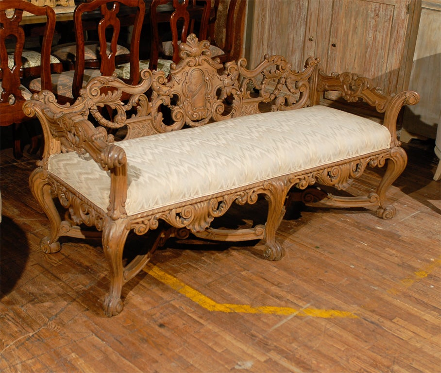 Late th century richly carved italian wooden bench with