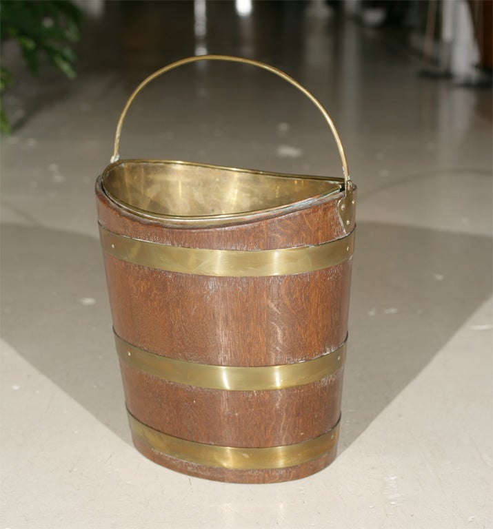 Offered here is an English or Irish Peat bucket made of Mahogany and brass with the original brass liner.