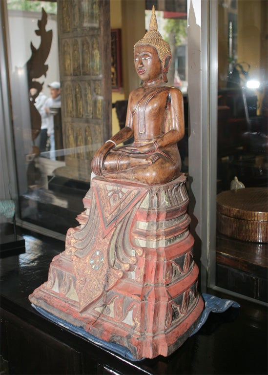 This spectacular seated Buddha sculpture from Thailand from the 17th-18th century displays the position of calling the earth to witness: during the meditation that will bring to the awakening, the Buddha resists the demon Mara's assault and calls