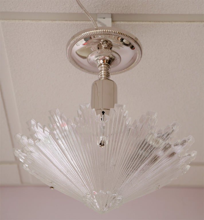 Starburst chandelier antique. Refinished in nickel.  Rewired.