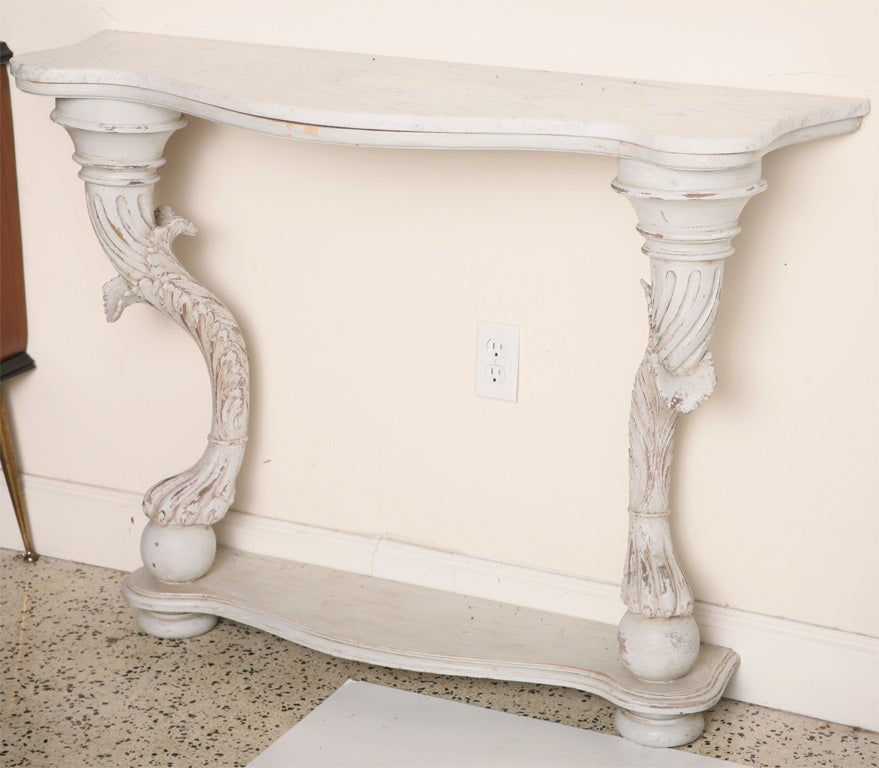 Georgeous Italian grey painted wood console. 2 legs with paw feet and acanthus leaves and  Italian Carrara marble top.