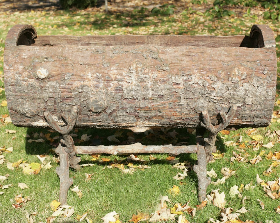 An exceptionally rare piece, this very large cast iron log planter with original but separate