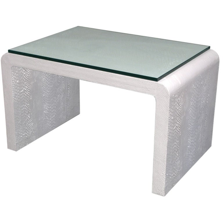White Waterfall Tables ~ Coffee table covered in white snake by karl springer at