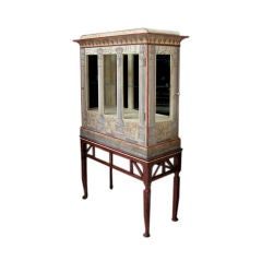 A Fanciful Egyptian-Inspired Polychromed 2-door Display Cabinet