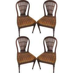 A set 4 balloon-back chairs attributed to Maison Jansen