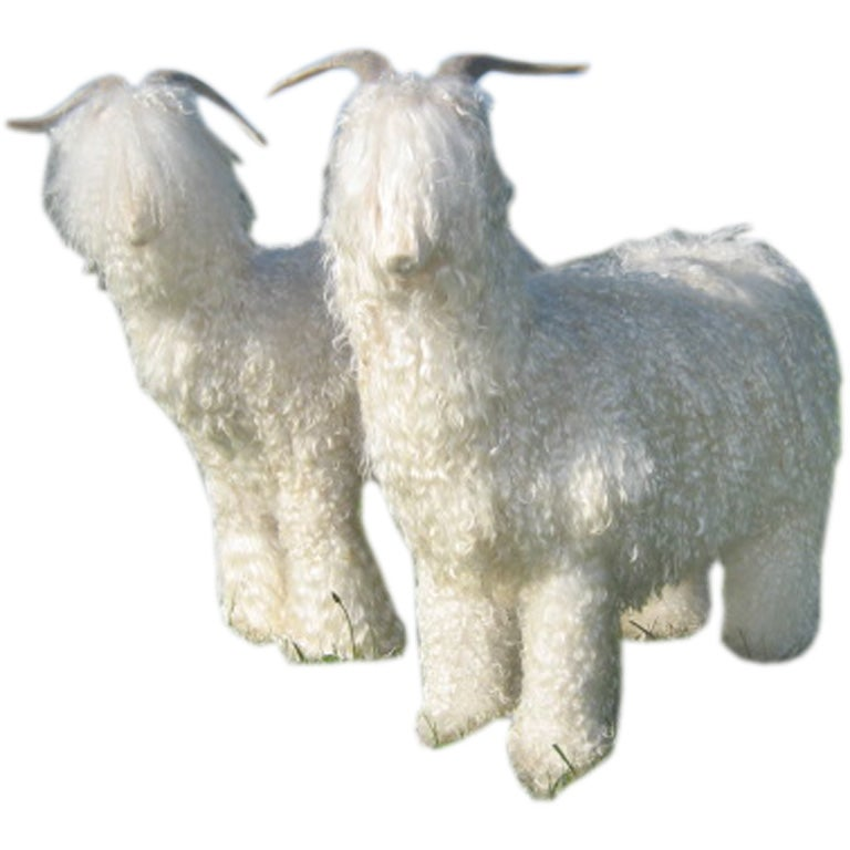 A Pair Of Stylish Sheep Ottomans At 1stdibs