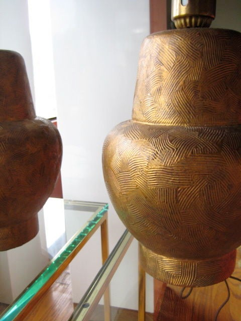 A great pair of gold leaf over wood Classic lamps by James Mont.