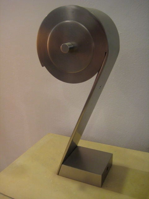A great French, modernist table lamp. Stainless steel in satin, brushed finish.
