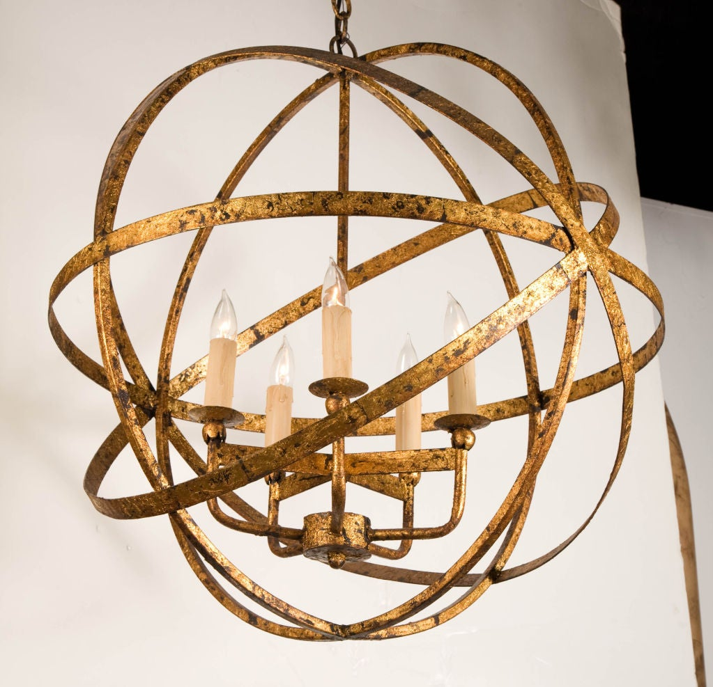 French gilt steel armillary chandelier at 1stdibs a giant armillary chandelier with a gilded steel finish composed of four large hoops in a arubaitofo Image collections