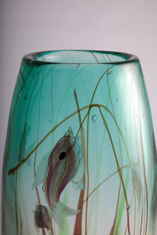 A colorful art glass vase in an oval form with multi-color fish swimming in a sea of aqua blue within coral and green colored plants. By Barbini. Italian, circa 1960.