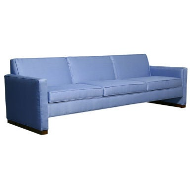 Light blue fabric sofa with walnut base by Dunbar