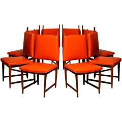 """Set of 8 """"Horned"""" rosewood and red leather dining chairs"""