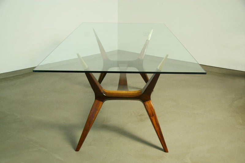 a sculptural exotic wood and bronze dining table with