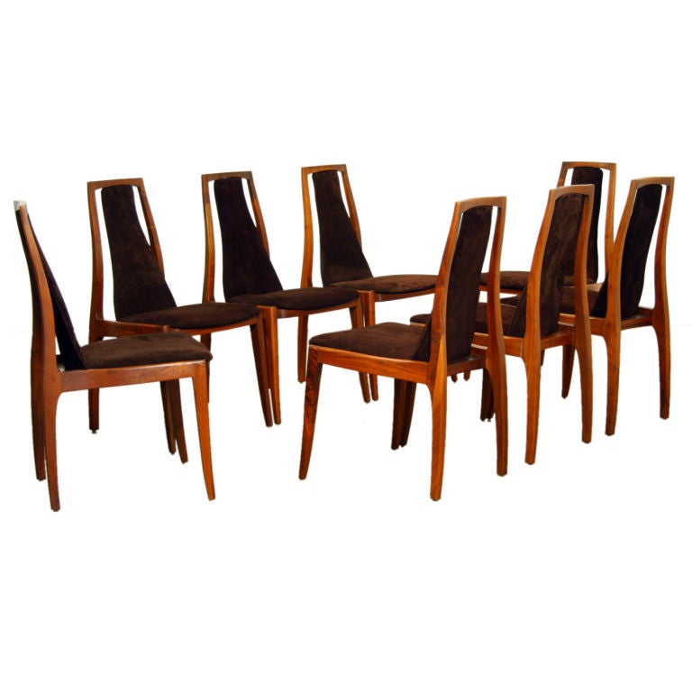 eight walnut and brown suede dining chairs by john kapel