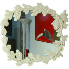 White plaster leaf pattern mirror in the style of Serge Roche