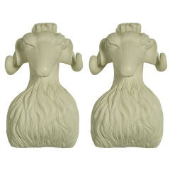 Pair of carved white plaster rams heads
