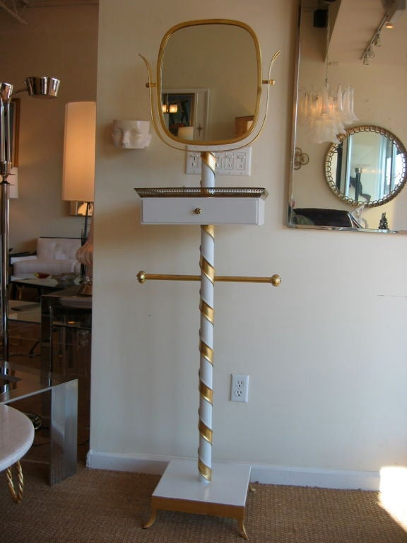 This original Italian mid century modern tall swivel mirror stand can incorporate so many different uses.   Is it a valet? Is it a stand? Is it a piece of art? Only one who looks in will see.  This artful Italian Venetian mirrored stand fashioned in