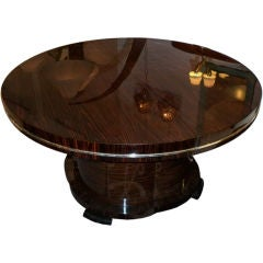 A Large Round Extending Art Deco Dining Table by J. DeCoene