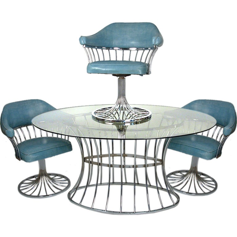 Chrome dining table with five swivel chairs at 1stdibs for Dining room table with swivel chairs