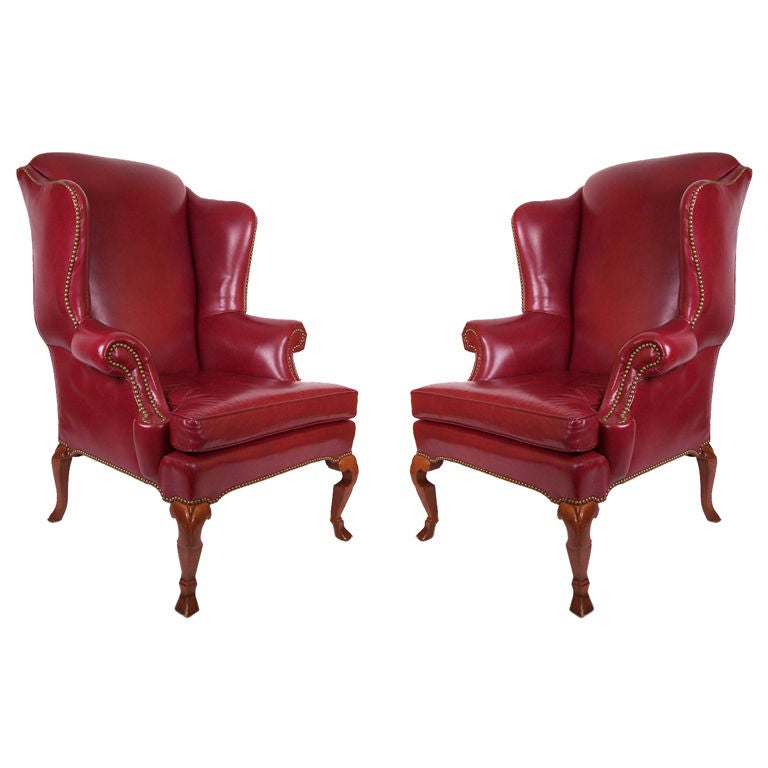 Pair Of Dark Red Leather Wing Chairs For