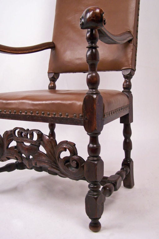 Early 18th century chair probably English with leather upholstery. Turned and carved wood detail.