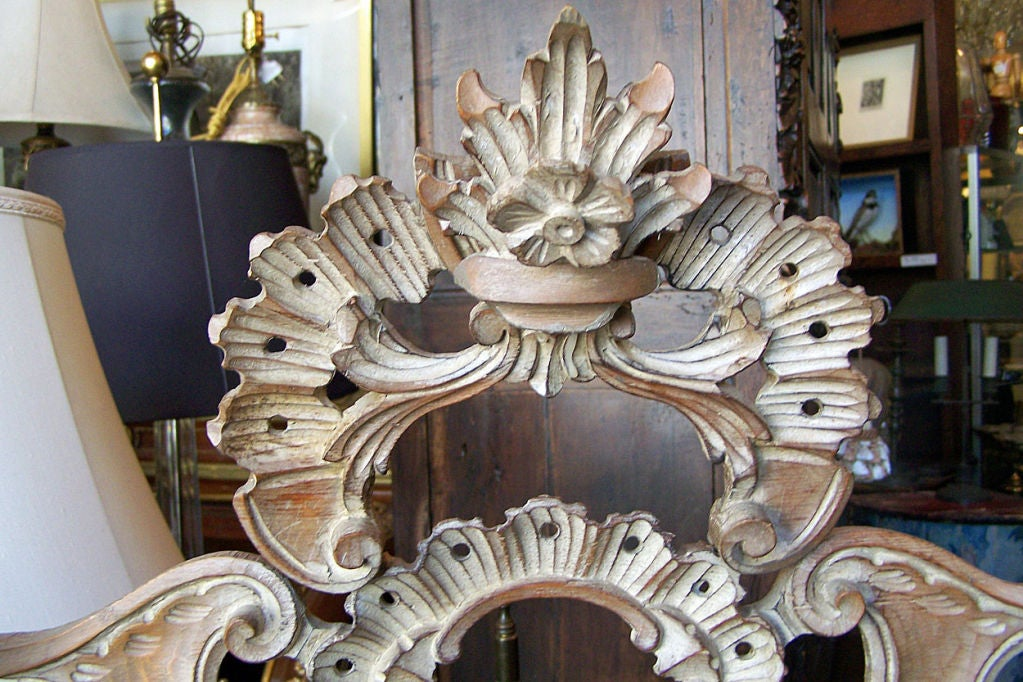 Elaborately Carved Rococo Style Framed Mirror with Pickeled Pine Finish.  Italian, Circa 1950.