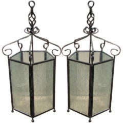 Pair of large wrought iron hanging lanterns