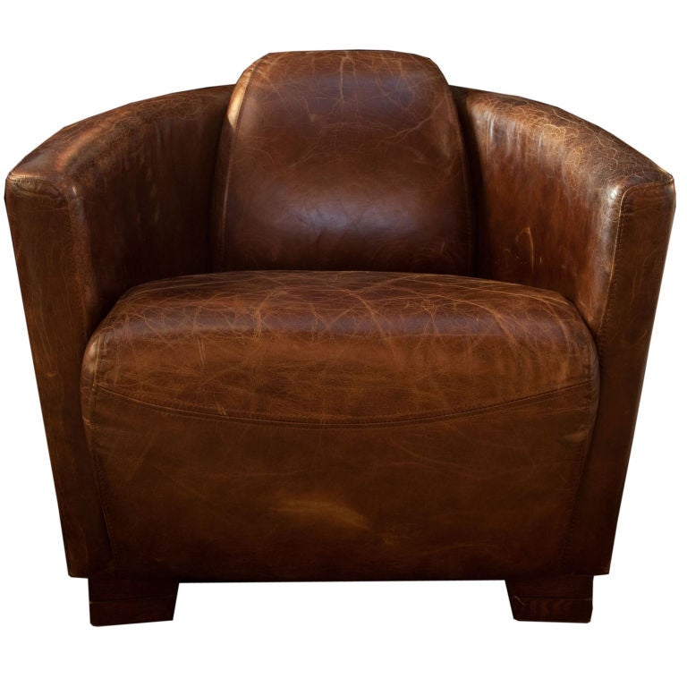 Distressed leather clubchair at 1stdibs