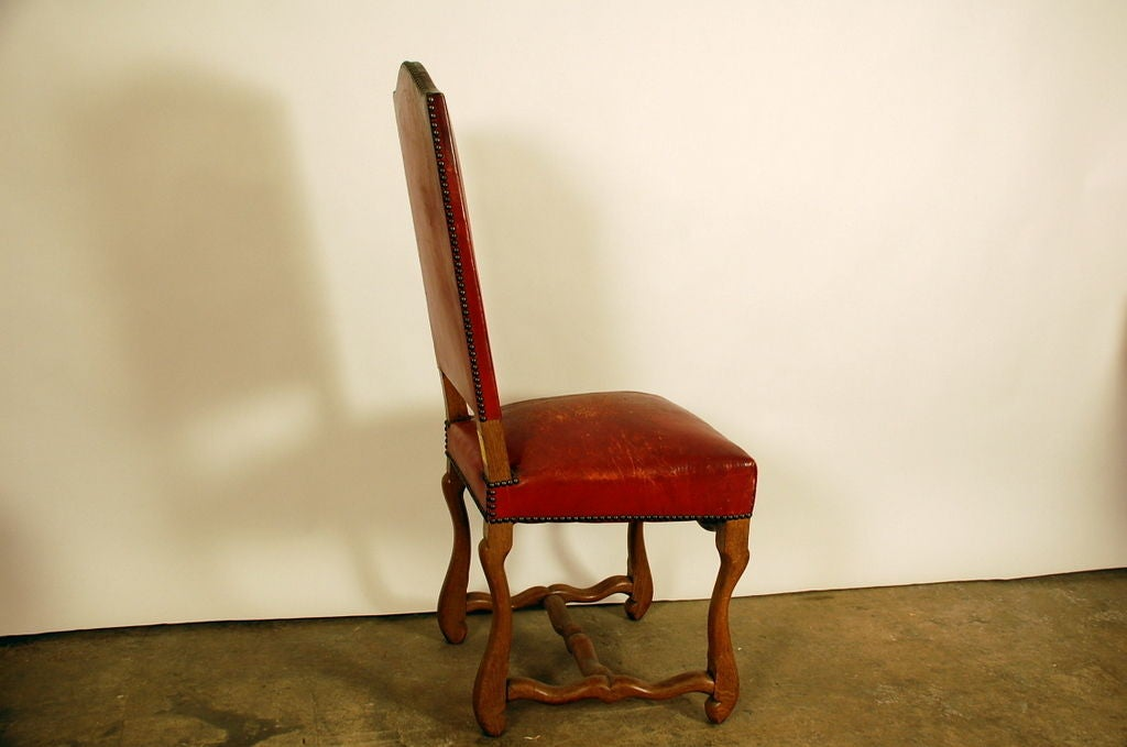 set of 8 large aged red leather french chateau dining chairs image 4