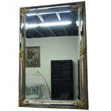 Curved Frame Mirror with Handcarved and Gold Leaf Decoration