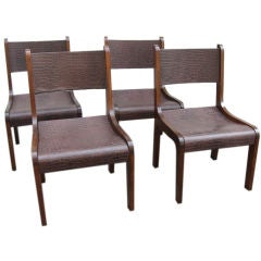 SET OF EIGHT BRAZILIAN ROSEWOOD AND LEATHER DINING CHAIRS