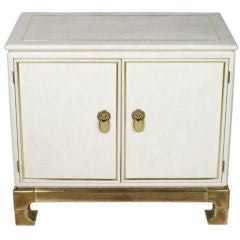 Mastercraft Asian Modern cabinet with brass base and details