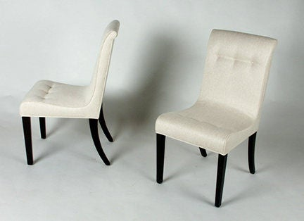 Set of four Edward Wormley side chairs with dark mahogany legs.
