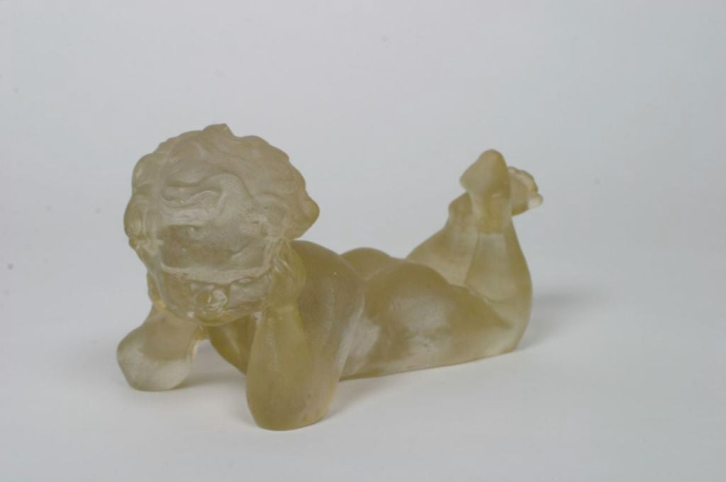 Resin cherub by Dorothy Thorpe, label on bottom.