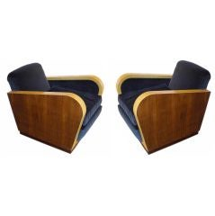 a pair of arm chairs