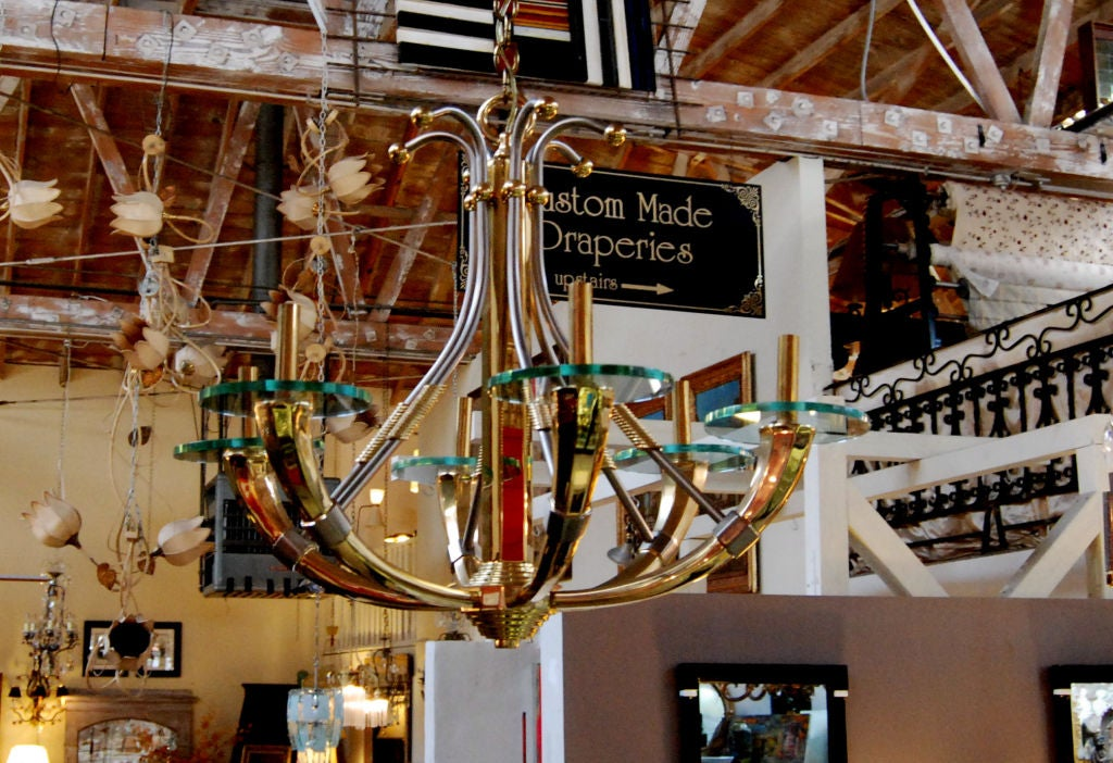1970 Six-light brass, steel and glass details chandelier in the style of Maison Jansen.