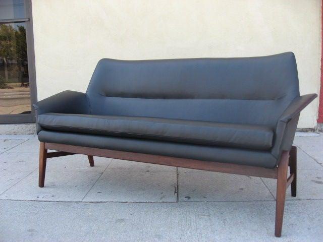 A Navy Blue Leather Danish Modern Sofa On Carved Teak Frame Image 2