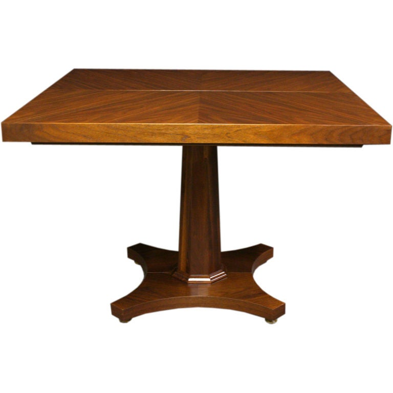 A Two Leaf Single Pedestal Extension Dining Table By