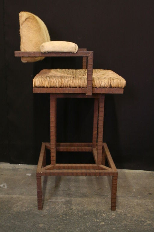 A Pair Of Handmade Iron And Pony Skin Barstool Directors