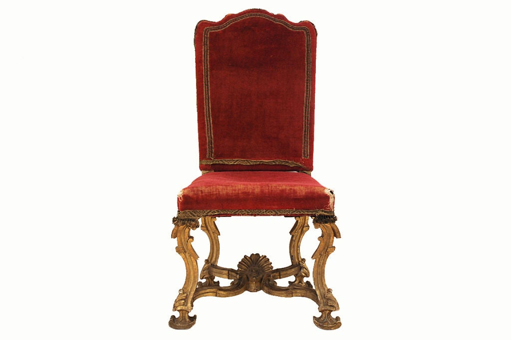 An italian baroque period finely carved giltwood dining for Baroque dining furniture