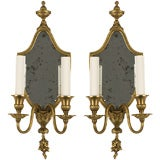 Double arm antique sconces with mirrored backplates
