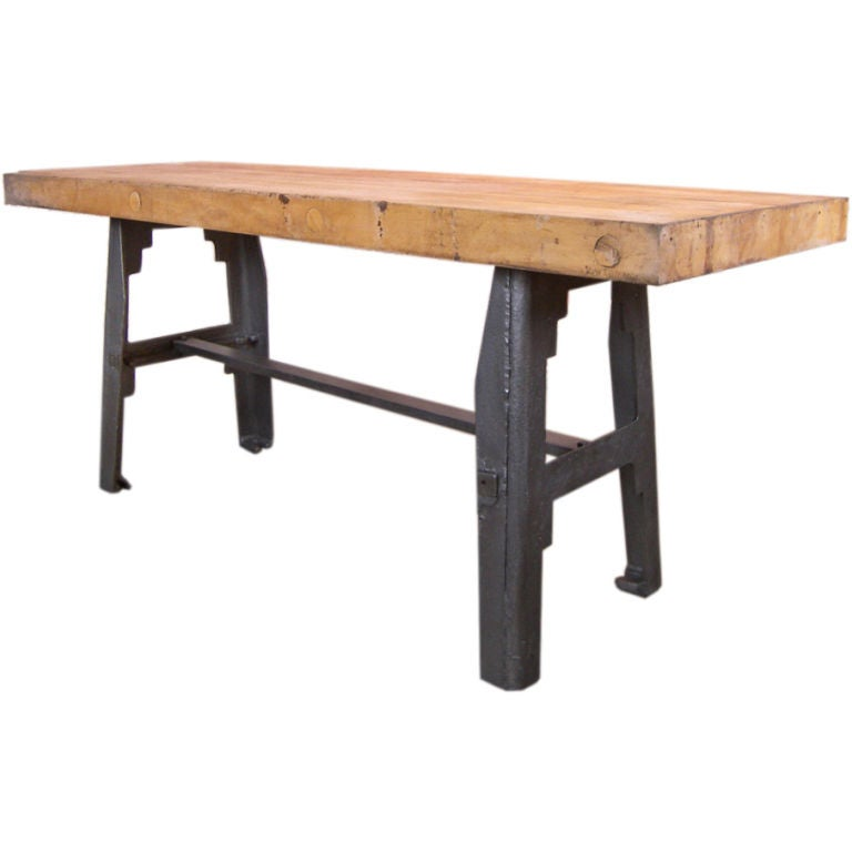 vintage industrial butcher block and cast iron table at