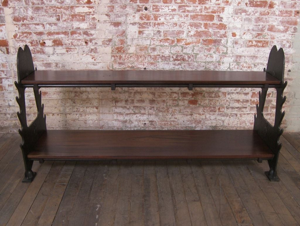 "Industrial cast iron and walnut shelving unit, storage rack, side table. Overall dimensions are 72 1/2"" x 22 3/4"" x 36 1/2"". Bottom shelf measures 69"" x 18"" with a height of 7 1/2"". Top shelf measures 69"" x"