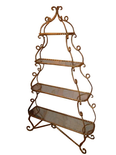 BEAUTIFUL LARGE SCALE GILT WROUGHT IRON ETAGERE.  4 GLASS SHELVES.