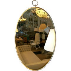 An Oval Mirror with Decorative Hanging Loop